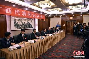 广西代表团审议全国人大常委会工作报告会后答记者问高清组图