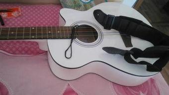弹吉他把手按肿了怎么办
