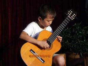 儿童初期怎样学弹吉他