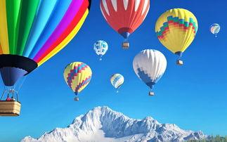 雪山上空的热气球图片