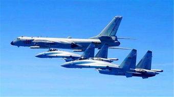 5月11日,空军苏-35战机与轰-6k战机编队飞行。
